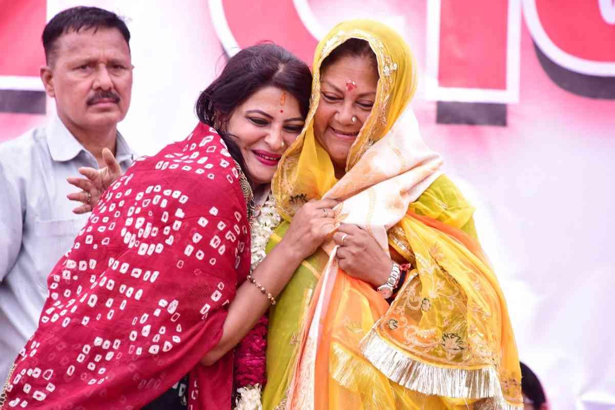 women hugging CM Raje