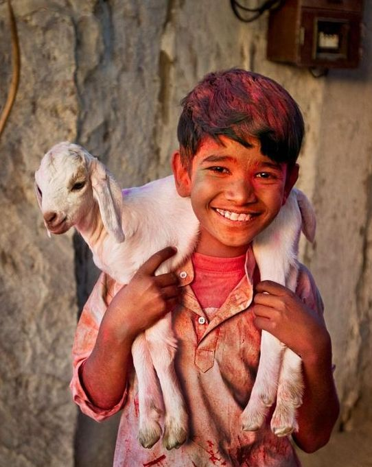 kid in holi colors