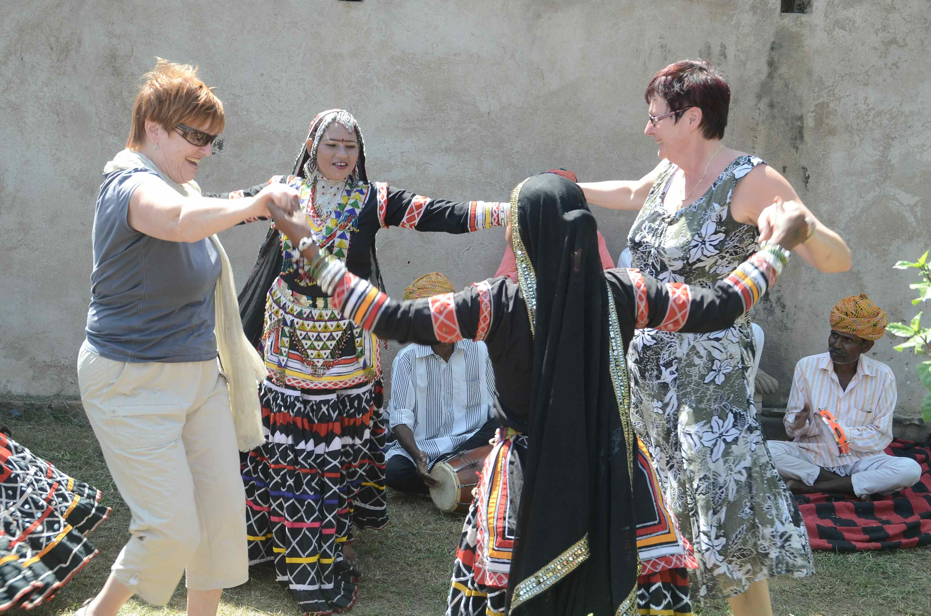 Dancers performing Kachchi Ghodhi dance, and the foreign guests joined in.